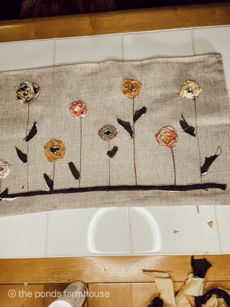 Easy decorative pillow cover made using scarp fabric and fabric glue.  Perfect farmhouse design for fall.