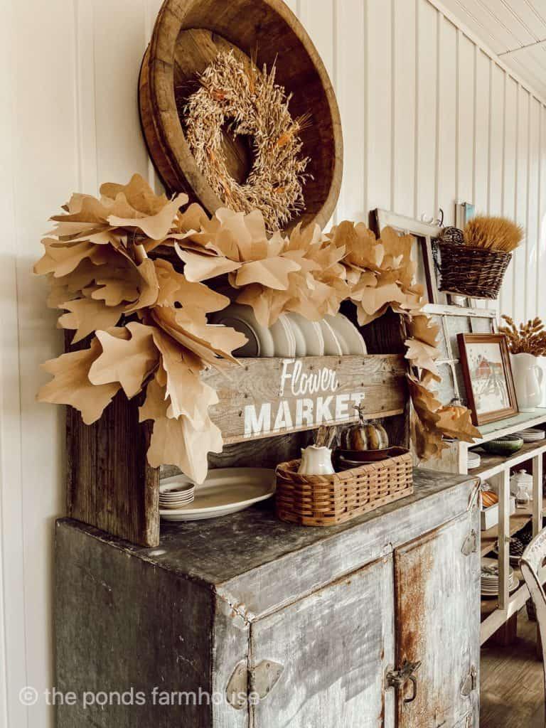 DIY Fall Leaf Garland displayed on a shelf. Easy Fall Craft